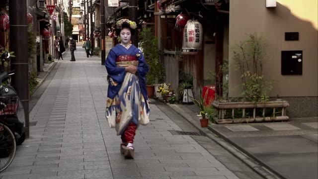 WS DS Maiko walking on street, Kyoto, Japan