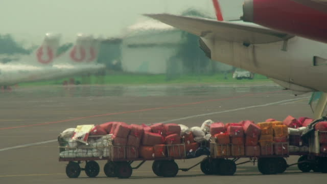 mail bags waiting to be loaded into airplane - mail stock videos and b-roll footage