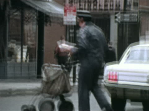 1969 pan mail carrier crossing street in traffic / greenwich village, nyc / industrial - greenwich village stock videos & royalty-free footage