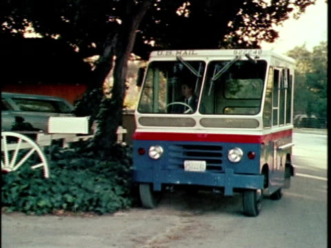 1970 ws mail delivery truck pulling up to suburban home and leaving mail, woman getting mail from mailbox, los angeles, california, usa, audio - united states postal service stock videos & royalty-free footage