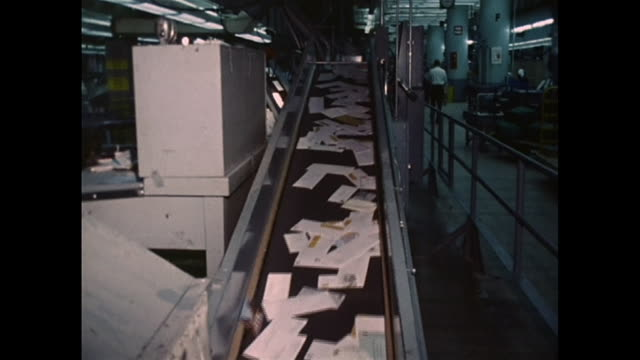 mail on a convenyor bet at the lax post office in 1970. - post structure stock videos & royalty-free footage