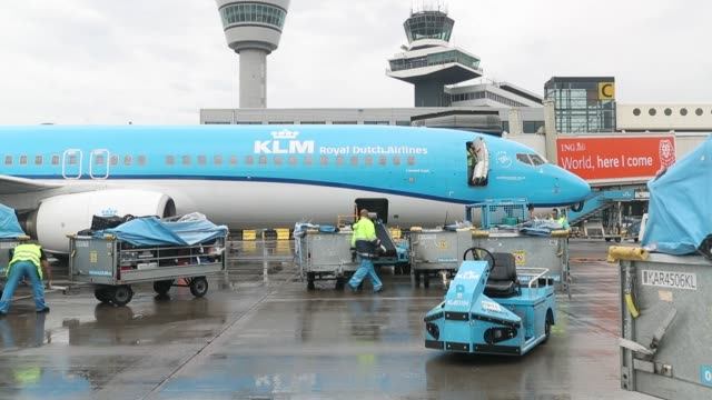 mail sacks and packages pass along a conveyor as they are loaded onto an aircraft operated by klm, the dutch arm of air france-klm group, on the... - 航空便点の映像素材/bロール