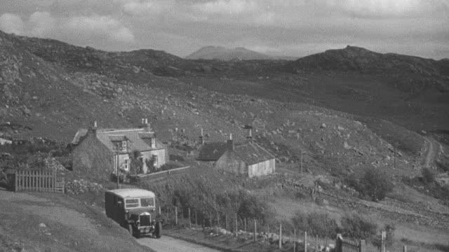 1944 montage mail truck delivering parcel on road by church and surrounding land of crofting community / achriesgill, scotland, united kingdom - achriesgill stock videos & royalty-free footage