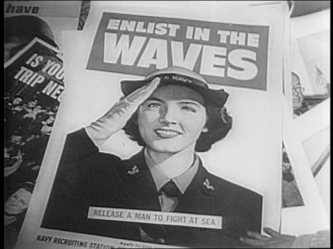 v mail war ration books and coupons/ woman's hand writing list as part of point and ration point program/ man putting up patriotic posters - world war ii stock videos & royalty-free footage