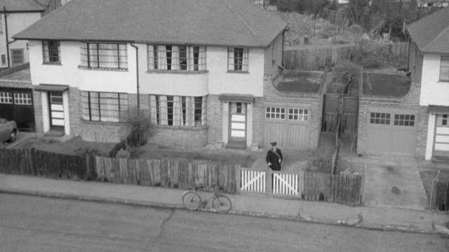 montage a mailman walking away from one house, grabbing his bicycle, and walking to the next house to deliver mail / united kingdom - postman stock videos and b-roll footage
