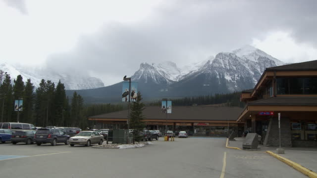 WS Main plaza in Lake Louise with snow capped Canadian Rockies in background / Alberta, Canada