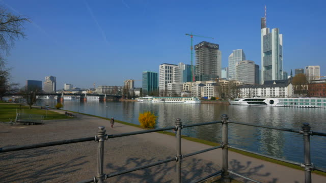 main river shore with skyline and commerzbank tower, frankfurt am main, hesse, germany - frankfurt main stock videos and b-roll footage