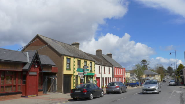 T/L Main road activity, scenic village of Glenbeigh on the Ring of Kerry, Ireland, nice clouds