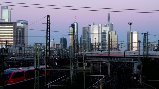 Main station Frankfurt am Main with skyline and moving train in evening dusk