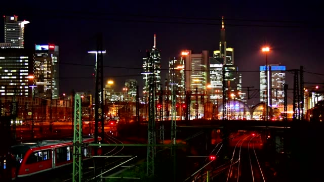 Main station Frankfurt am Main with skyline and moving trains in the night