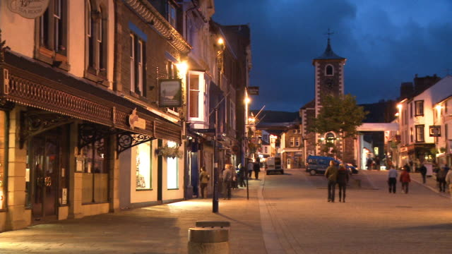 WS, PAN, Main street and Moot hall illuminated at dusk, Keswick, Cumbria, England