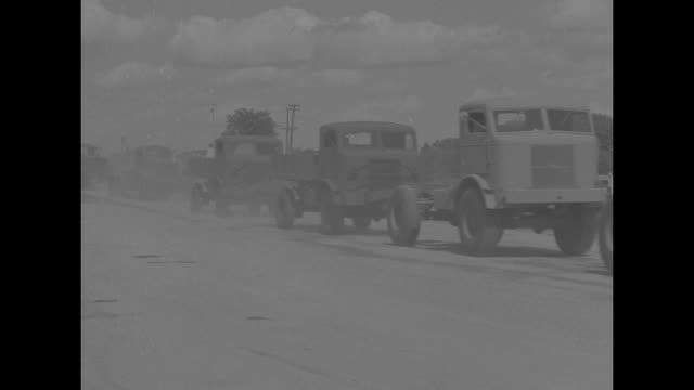"main street, cars parked along sides, american flags line sidewalks / roadside billboard: ""home of fwd four wheel drive trucks, a wisconsin product... - man and machine stock videos & royalty-free footage"