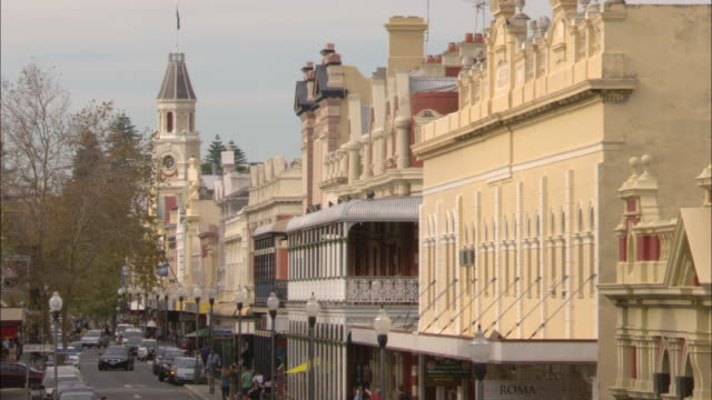 main street fremantle overcast day pedestrians and traffic clock tower in background - main tower stock videos and b-roll footage