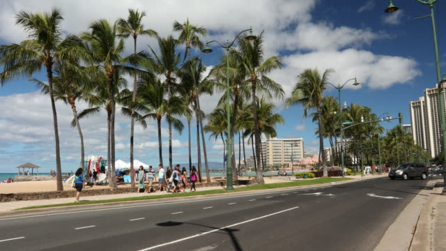 main street kalakaua avenue in waikiki beach hawaii usa - hawaii islands stock videos and b-roll footage