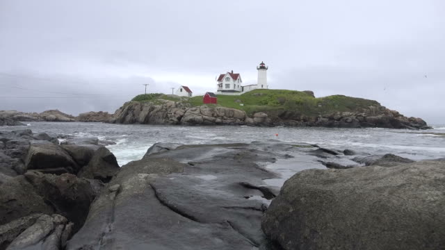Maine Lighthouse Behind Rocky Shore
