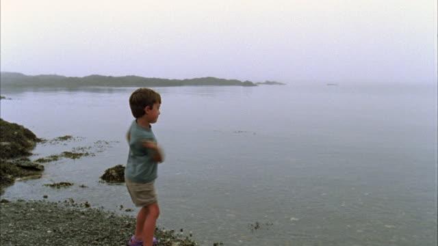 MS, USA, Maine, North Haven, Boy (6-7) skipping stones on beach