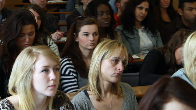 mainly young women at university lecture - lecture hall stock videos & royalty-free footage