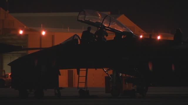 Maintenance crew members of the 391st Fighter Squadron at Mountain Home Air Force Base Idaho work on one of their F15E Strike Eagles during Red Flag...