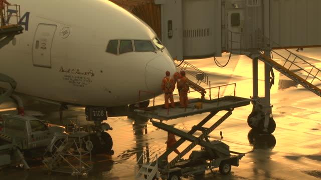 maintenance crews checking airplane at airport - repairing stock videos & royalty-free footage