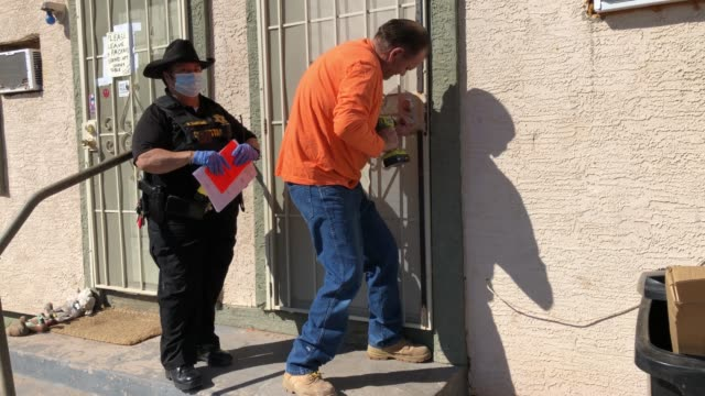 maintenance man breaks the lock of a house as maricopa county constable darlene martinez serves an eviction order on october 7, 2020 in phoenix,... - united states congress video stock e b–roll