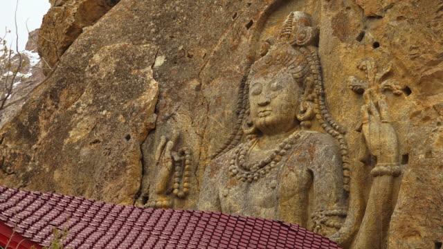 maitreya buddha statue, mulbekh monastery, kargil - buddha stock videos & royalty-free footage