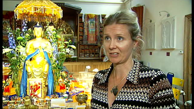 sacred relics put on show at jamyang buddhist centre england london kennington jamyan buddhist centre int phial holding pearllike 'crystals' andy... - 古代の遺物点の映像素材/bロール