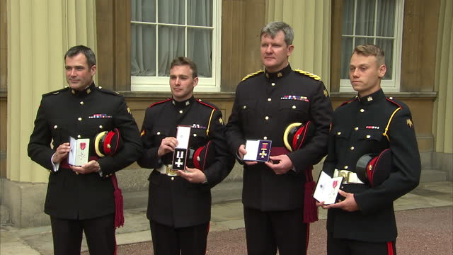 maj adam wolfe mbe lc cpl lawrence kayser mc lt col michael aston dso and lc cpl lewis treloar mbe from the royal anglian regiment after having their... - order of the british empire stock videos and b-roll footage