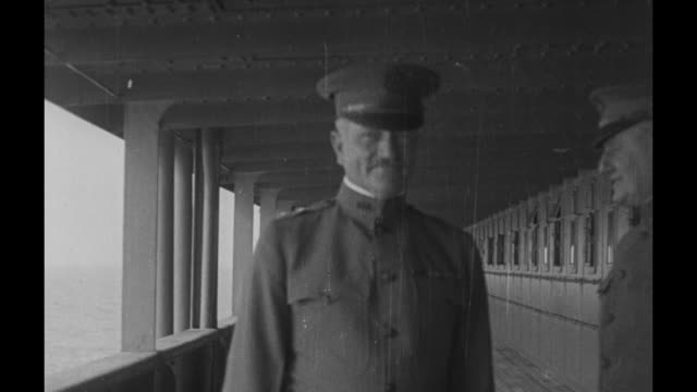 us maj gen john j pershing walks with another officer as he approaches camera while aboard the rms baltic / vs he poses for photo opportunity... - ピーリング点の映像素材/bロール