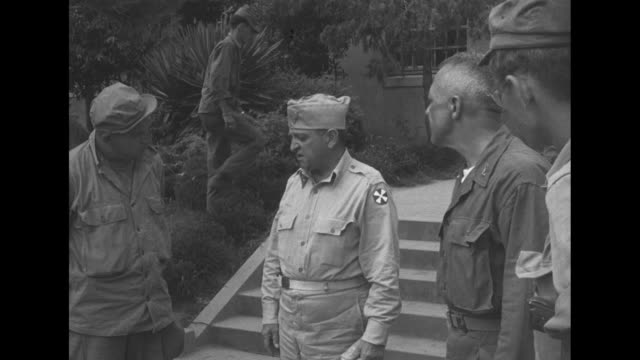 maj gen william kean commanding general of 25th infantry division coming out of building with us lt gen walton walker commander of 8th us army and... - paramount building stock videos and b-roll footage