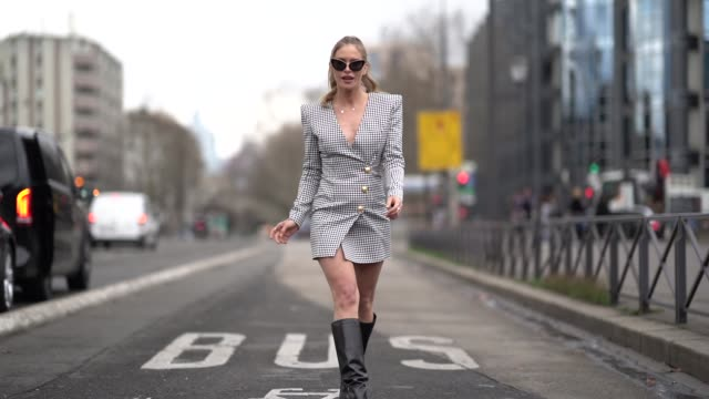maja malnar wears a black and white geometric pattern printed dress with golden buttons black boots sunglasses outside balmain during paris fashion... - gold dress stock videos & royalty-free footage