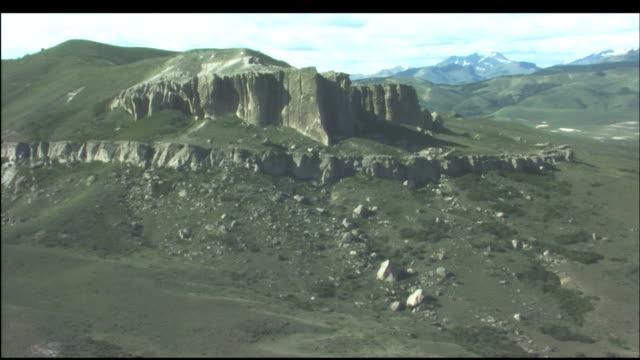 stockvideo's en b-roll-footage met a majestic cliff face gives way to unusual rock spires. - kerktoren