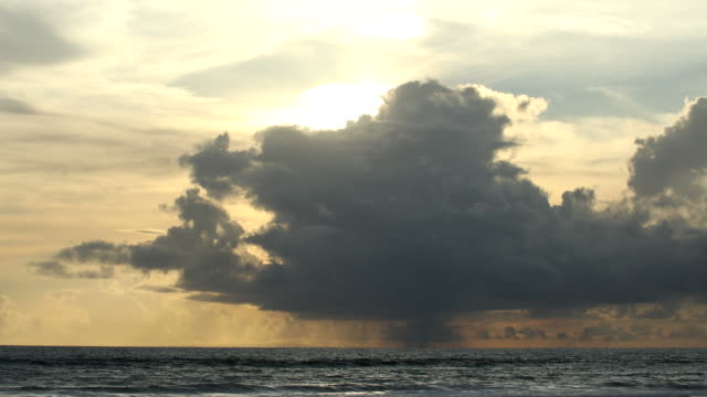 majestic cloud formation at sea with sunset behind - monsoon stock videos & royalty-free footage