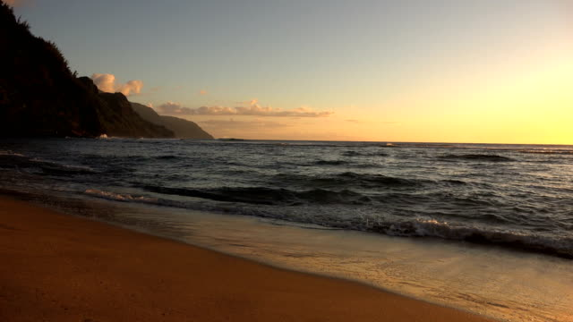majestic colors from sunset on horizon and beach on kauai island - butte rocky outcrop stock videos & royalty-free footage