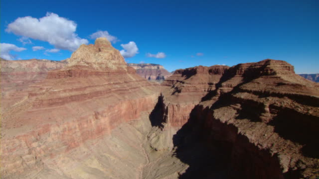 majestic mesas of the grand canyon rise into a brilliant blue sky. - majestic stock videos & royalty-free footage