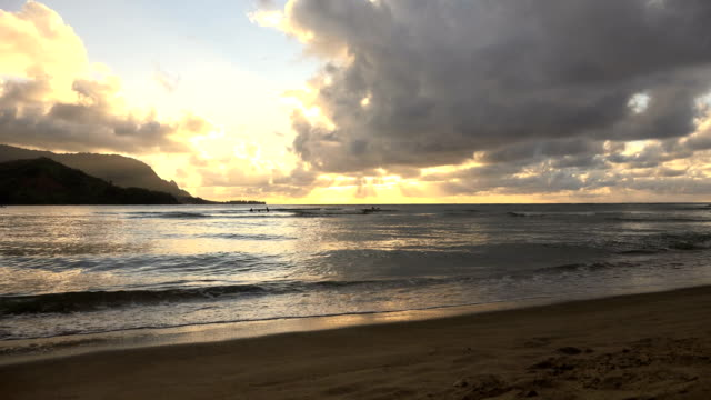 majestic sunset behind clouds on kauai island - majestic stock videos & royalty-free footage