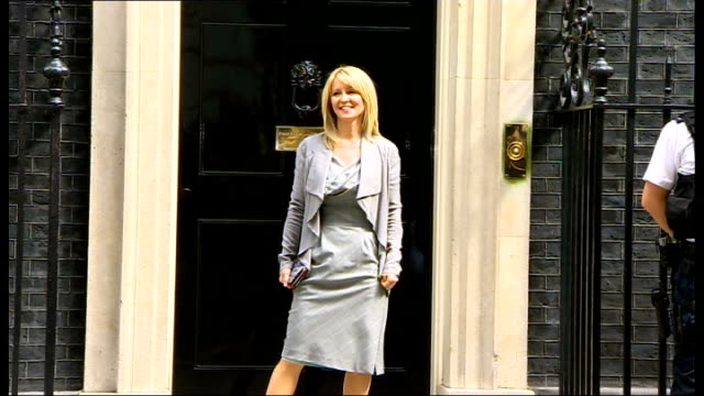 major cabinet reshuffle: more women selected / michael gove replaced as education secretary; ext esther mcvey mp posing for press outside 10 downing... - 内閣改造点の映像素材/bロール