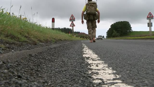 major chris brannigan completes barefoot walking challenge to raise money for daughter suffering with cdls scotland ext various of major chris... - barefoot stock videos & royalty-free footage