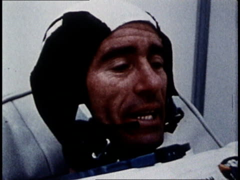 major cunningham in space suit reclining in chair / apollo 7 leaving pad during take off - 1968年点の映像素材/bロール