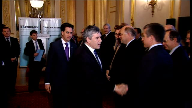 'Major Economies Forum on Energy and Climate' held in London ENGLAND London PHOTOGRAPHY** Gordon Brown MP accompanied by Ed Miliband MP shaking hands...