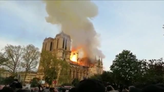 """major fire has broken out in france's famous medieval cathedral notre-dame on monday, officials said. """"a terrible fire has broke out at notre-dame de... - notre dame de paris stock videos & royalty-free footage"""
