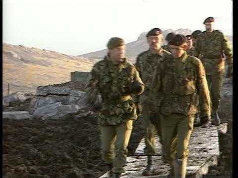 Major General David Thorne visits 'Mount Zeus' FALKLANDS 'Mount Zeus' EXT Accommodation unit held aloft by helicopter ZOOM Royal Engineers struggling...
