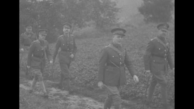 vs major general edward duke of windsor and british field marshall john vereker in uniforms walking amongst troops / vereker and french army general... - field marshal stock videos and b-roll footage