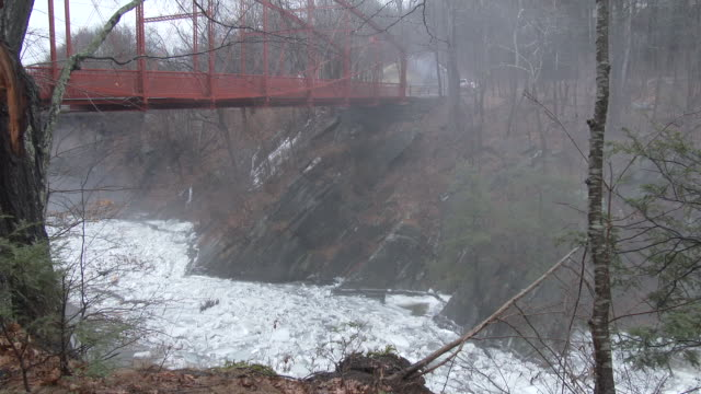 A major ice jam forms along the Housatonic River in New Milford Connecticut under Lover's Leap Bridge as thick fog slowly rolls over the landscape