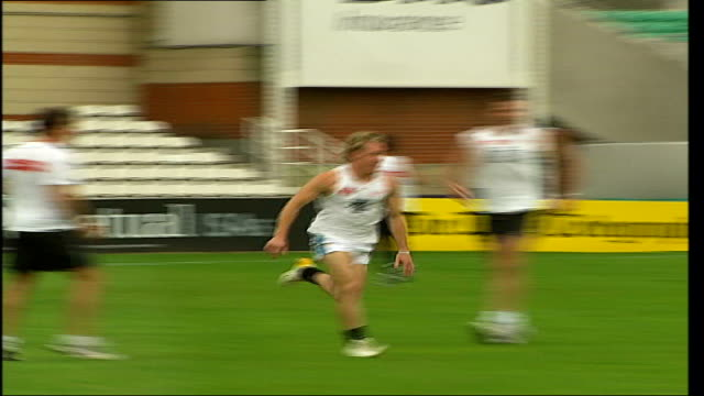 Major NFL game to be played in London TX The Oval EXT Members of Port Adelaide Power Australian Rules team training on pitch during Aussie Rules...