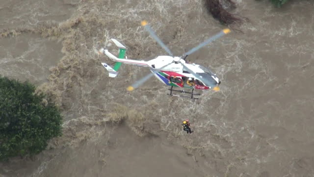 A major river in eastern Japan breached its banks on Thursday following torrential rain flooding hundreds of home and leaving at least one person...