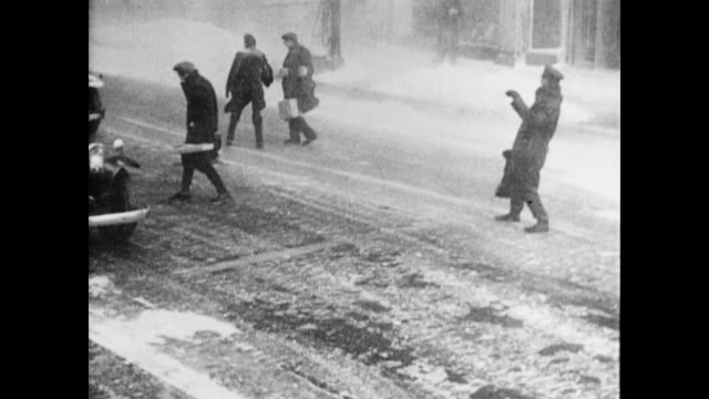 Major snowstorm blows people across streets