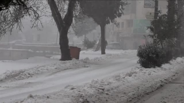 a major storm dumped rare snow on parts of the middle east wednesday - gefrorenes wasser stock-videos und b-roll-filmmaterial