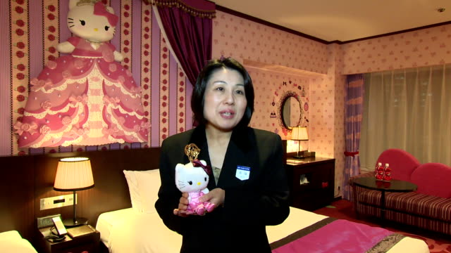 """a major tokyo hotel operator said it will open special guest rooms decorated with """"hello kitty"""" cat character to commemorate the 40th anniversary of... - hello kitty stock videos and b-roll footage"""