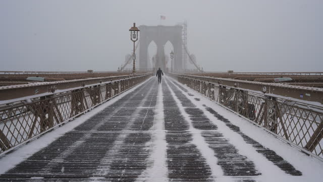 major winter snowstorm hits new york city during the pandemic of covid-19 2021 - suspension bridge stock videos & royalty-free footage