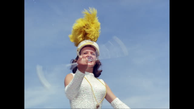 ms tu majorette twirling baton, hats and confetti being thrown / united states - hüten stock-videos und b-roll-filmmaterial